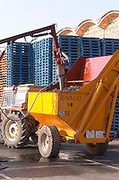 Grape delivery with tractors and containers. Probe to test the grape must at reception. Raimat Costers del Segre Catalonia Spain