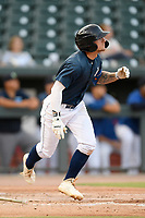 Second baseman Chandler Avant (5) of the Columbia Fireflies runs out a batted ball in a game against the Rome Braves on Tuesday, June 4, 2019, at Segra Park in Columbia, South Carolina. Columbia won, 3-2. (Tom Priddy/Four Seam Images)