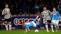 Calcio, Serie A: Napoli vs Juventus. Napoli, stadio San Paolo, 30 marzo 2014. <br /> Napoli midfielder Gokhan Inler, of Switzerland, falls on the pitch past Juventus forward Fernando Llorente, of Spain, left, midfielder Arturo Vidal, of Chile, second from right, and Napoli midfielder Jorginho, of Brazil, right, during the Italian Serie A football match between Napoli and Juventus at Naples' San Paolo stadium, 30 March 2014.<br /> UPDATE IMAGES PRESS/Isabella Bonotto