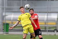 Thomas Raimbault of the Wellington Phoenix competes for the ball with Tom Schwarz of Canterbury United during the ISPS Handa Men's Premiership - Wellington Phoenix Reserves v Canterbury United at Fraser Park, Wellington on Saturday 9 January 2021.<br /> Copyright photo: Masanori Udagawa /  www.photosport.nz
