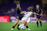 ORLANDO, FL - SEPTEMBER 11: Meggie Dougherty Howard #28 of the Orlando Pride and Lauren Milliet #2 of Racing Louisville FC battle for the ball during a game between Racing Louisville FC and Orlando Pride at Exploria Stadium on September 11, 2021 in Orlando, Florida.