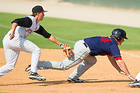 Bryce Harper #34 of the Hagerstown Suns is tagged out by Ross Wilson #2 of the Kannapolis Intimidators after getting caught in a rundown at Fieldcrest Cannon Stadium on May 30, 2011 in Kannapolis, North Carolina.   Photo by Brian Westerholt / Four Seam Images