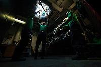 120210-N-DR144-527 ARABIAN SEA (Feb. 10, 2012) Aviation Boatswain's Mate (Equipment) 3rd Class Roy Dye, left, Aviation Boatswain's Mate (Equipment) 3rd Class Christopher Jaramillo, center, and Aviation Boatswain's Mate (Equipment) 3rd Class Ohene Danso, right, stow barricades below decks after flight deck drills aboard the Nimitz-class aircraft carrier USS Carl Vinson (CVN 70). Carl Vinson and Carrier Air Wing (CVW) 17 are deployed to the U.S. 5th Fleet area of responsibility.  (U.S. Navy photo by Mass Communication Specialist 2nd Class James R. Evans/Released)