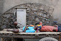 Workers sleeping in the shade at an industrial estate in Kolkata.<br /> <br /> To license this image, please contact the National Geographic Creative Collection:<br /> <br /> Image ID: 1925755<br />  <br /> Email: natgeocreative@ngs.org<br /> <br /> Telephone: 202 857 7537 / Toll Free 800 434 2244<br /> <br /> National Geographic Creative<br /> 1145 17th St NW, Washington DC 20036