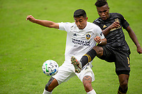 LOS ANGELES, CA - OCTOBER 25: Julian Araujo #22 of the Los Angeles Galaxy and Jose Cifuentes #11 of LAFC battle during a game between Los Angeles Galaxy and Los Angeles FC at Banc of California Stadium on October 25, 2020 in Los Angeles, California.