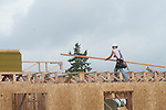 construction Workers Working on a Roof