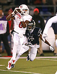 Fresno State's Delvon Hardaway makes a reception against Nevada defender Evan Favors during the first half of an NCAA college football game in Reno, Nev., on Saturday, Nov. 22, 2014. Fresno State won 40-20. (AP Photo/Cathleen Allison)