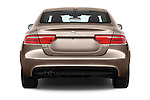 Straight rear view of 2015 Jaguar XE R-Sport 4 Door Sedan Rear View  stock images