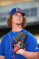 Midland RockHounds pitcher Grant Holmes (16) poses for a photo before a game against the Northwest Arkansas Naturals on May 27, 2017 at Arvest Ballpark in Springdale, Arkansas.  NW Arkansas defeated Midland 3-2.  (Mike Janes/Four Seam Images)