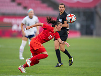 KASHIMA, JAPAN - AUGUST 2: Jessie Fleming #17 of Canada sprints forward during a game between Canada and USWNT at Kashima Soccer Stadium on August 2, 2021 in Kashima, Japan.