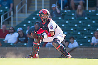Salt River Rafters catcher Tres Barrera (12), of the Washington Nationals organization, looks to apply the tag to Charles Leblanc (not pictured) during an Arizona Fall League game against the Surprise Saguaros at Salt River Fields at Talking Stick on November 5, 2018 in Scottsdale, Arizona. Salt River defeated Surprise 4-3 . (Zachary Lucy/Four Seam Images)