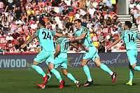 Shane Duffy and Lewis Dunk of Brighton & Hove Albion congratulate Leandro Trossard after scoring their only goal of the match during Brentford vs Brighton & Hove Albion, Premier League Football at the Brentford Community Stadium on 11th September 2021