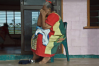 An elderly woman from Lalomanu talks to family members as she takes refuge in a church hall positioned on higher ground. More than 170 people died when a tsunami triggered by an 8.3 magnitude earthquake hit Samoa and neighbouring Pacific islands on 29/09/2009. Samoa (formerly known as Western Samoa)..