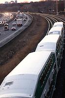 Commuter Train beside highway Toronto Ontario Canada