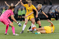 June 7, 2016: BETSY HASSETT (12) of New Zealand and ELISE KELLOND-KNIGHT (8) of Australia fight for the ball during an international friendly match between the Australian Matildas and the New Zealand Football Ferns as part of the teams' preparation for the Rio Olympic Games at Etihad Stadium, Melbourne. Photo Sydney Low