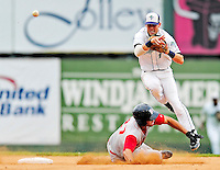 21 August 2010: Vermont Lake Monsters' infielder Jason Martinson gets Cory Vaughn out at second and completes the double against the Brooklyn Cyclones at Centennial Field in Burlington, Vermont. The Cyclones defeated the Lake Monsters 8-7 in a 12-inning game that had to be resumed in Brooklyn on August 31 due to late inning rain. Mandatory Credit: Ed Wolfstein Photo