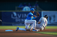 Myrtle Beach Pelicans shortstop Aramis Ademan (11) fields a throw as Steele Walker (6) of the Winston-Salem Dash slides into second base at TicketReturn.com Field on May 16, 2019 in Myrtle Beach, South Carolina. The Dash defeated the Pelicans 6-0. (Brian Westerholt/Four Seam Images)