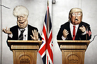 Caricature of Prime Minister Boris Johnson and US President Donald Trump on large advertisement board for satirical television puppet show Spitting Image inside Westminster Tube Station. London September 30th 2020<br /> <br /> Photo by Keith Mayhew