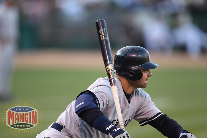 OAKLAND, CA - JULY 6:  Nick Swisher #33 of the New York Yankees bats against the Oakland Athletics during the game at the Oakland-Alameda County Coliseum on July 6, 2010 in Oakland, California. Photo by Brad Mangin
