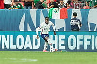 DENVER, CO - JUNE 6: Tim Weah #21 of the United States moves with the ball during a game between Mexico and USMNT at Mile High on June 6, 2021 in Denver, Colorado.