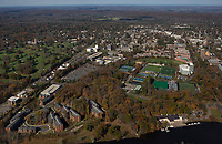 aerial photograph of Princeton University, Princeton, Mercer County, New Jersey from Carnegie Lake.  The graduate college is on the left adjacent to Springdale Golf Course, Lakeside Graduate housing is in the foreground left, the rowing center and boathouse is in the foreground right,  Roberts Staduium, Poe Field, Pardee Field and the Princeton Neuroscience Institute are in the middle ground toward the right.