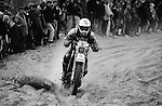 Enduro du Touquet 1987. Dirt bike beach race at Le Touquet, Normandy, France. --- No releases available, but releases may not be necessary for certain uses. Automotive trademarks are the property of the trademark holder, authorization may be needed for some uses. --- Info: A thousand motorcycles take part in this mad event. The race starts along the beach, followed by a run into the sand dunes. The entry point in the dunes is most spectacular: All motorbikes have to pass through a small opening in the dunes. Once the fast professional drivers have flown through, this first passage developes into a true bottleneck with many hundreds of motorbikers trying to get through at the same time. Motorcycles are strewn all over the place. Many have fallen, others have already broken down. In the meantime, the professional riders are progressing quickly. But their riding style changes from racing full-out as soon as they are approaching the lappers from behind. Outmaneuvering them at high speeds is an art form! After three hours it's all over.....