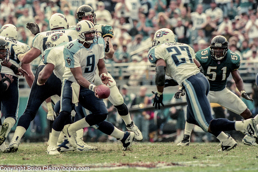 QB Steve McNair, #9, hands off to RB Eddie George, #27, during the NFL AFC Championship game, which the Tennessee Titans won over the Jacksonville Jaguars 33-14 on January 23, 2000 in Jacksonville, FL.  (Photo by Brian Cleary/bcpix.com)