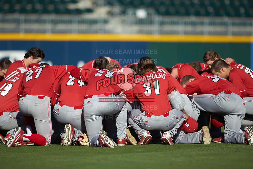The North Carolina State Wolfpack huddle up prior to the game against the Charlotte 49ers at BB&T Ballpark on March 29, 2016 in Charlotte, North Carolina. The Wolfpack defeated the 49ers 7-1.  (Brian Westerholt/Four Seam Images)