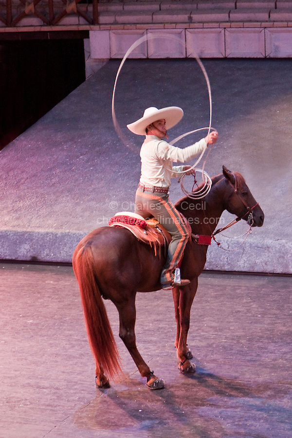 "Demonstrating Tricks with a Rope, Performance of ""Mexico Espectacular"", Xcaret, Playa del Carmen, Riviera Maya, Yucatan, Mexico."