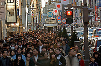Crowds of shoppers in the upmarket Ginza shopping district, Tokyo, Japan..