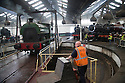"""25/09/15<br /> <br /> Steam trains use the turntable in Britain's only remaining operational roundhouse at Barrow Hill. The three day event  """"Barrow Hill '65 – the London Midland Region Steam Gala of the Year"""" which started today, marks fifty years since the last regular steam train left the LMS (London Midland and Scottish) yard near Chesterfield, Derbyshire. The locomotives on show for the steam gala weekend are a mix of passenger and freight steam engines, all looking and numbered as they would have been in September 1965. Main line locomotives are still serviced in the depot today.<br /> <br /> All Rights Reserved: F Stop Press Ltd. +44(0)1335 418365   +44 (0)7765 242650 www.fstoppress.com"""