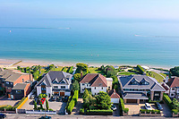BNPS.co.uk (01202 558833)<br /> Pic: Savills/BNPS<br /> <br /> Pictured: The house and the panoramic sea view.<br /> <br /> A clifftop home with breathtaking panoramic sea views is on the market for £3.25m.<br /> <br /> Sandpierre also has a private swimming pool and a viewing platform overlooking the beach with 180-degree views of the water. <br /> <br /> The six-bedroom family home is on the Bournemouth/Poole coastline in Dorset and is being sold for the first time in 25 years.<br /> <br /> The house was built in the 1930s and is in a quiet cul-de-sac in Branksome Dene Chine - midway between the town centres of Bournemouth and Poole.