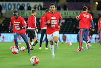 """Neil Taylor of Swansea warms up wearing a """"Show Racism the Red Card"""" shirt before the Barclays Premier League match between Swansea City and Stoke City played at the Liberty Stadium, Swansea on October 19th 2015"""