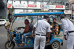 Kolkata police stops a toto carrying passengers to find out the reason for moving out of house during 21 days lock down in the country due to covid 19 pandemic. If commuters can not prove a suitable reason they are either sent back to home or being arrested for violating  lock down laws. Kolkata, West Bengal, India. Arindam Mukherjee.