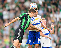 AUSTIN, TX - JUNE 19: Matt Besler #5 of Austin FC and Chris Wondolowski #8 of the SJ Earthquakes go up for a header at the same time during a game between San Jose Earthquakes and Austin FC at Q2 Stadium on June 19, 2021 in Austin, Texas.