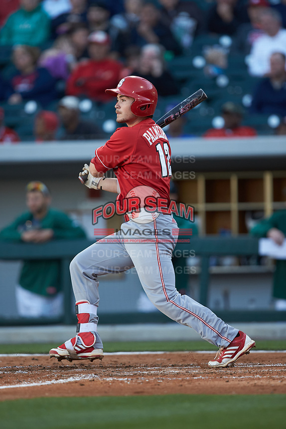 Preston Palmeiro (12) of the North Carolina State Wolfpack follows through on his swing against the Charlotte 49ers at BB&T Ballpark on March 29, 2016 in Charlotte, North Carolina. The Wolfpack defeated the 49ers 7-1.  (Brian Westerholt/Four Seam Images)