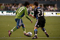 Fredy Montero (l) drives against Michael Zaher (23) in the Seattle Sounders 2-1 win against San Jose Earthquake on Saturday, June 13, 2009 at Quest Field in Seattle, WA.