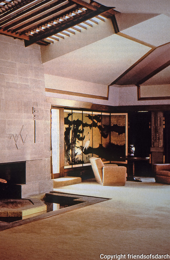 """Frank Lloyd Wright:  Aline Barnsdall """"Hollyhock House"""", Hollywood, 1917. The area around the fireplace has 4 elements: fire, water (in front), stone or earth (abstract mural over the fireplace, and air (stained glass skylight above the fireplace). Photo Dec. 1987."""
