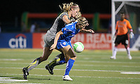 Philadelphia defender, Allison Falk (3) applies pressure to Boston defender, Taryn Hemmings (25).  Philadelphia took an early lead, but Boston stormed back with two goals to capture the win, 2-1, at Farrell Stadium in West Chester, PA.