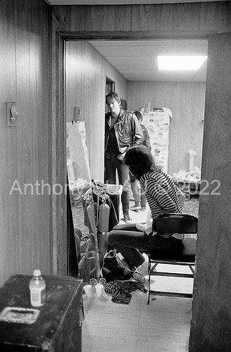 """Denver, Colorado<br /> USA<br /> May 9, 1983<br /> <br /> Back stage with the Ramones singer: Joey Ramone (sitting) and drummer (standing) Tommy Ramone.<br /> <br /> The Ramones were an American rock band that formed in Forest Hills, Queens, New York in 1974, often cited as the first punk rock group. Despite achieving only limited commercial success, the band was a major influence on the punk rock movement both in the United States and the United Kingdom.<br /> <br /> All of the band members adopted pseudonyms ending with the surname """"Ramone"""", though none of them were actually related. They performed 2,263 concerts, touring virtually nonstop for 22 years. In 1996, after a tour with the Lollapalooza music festival, the band played a farewell show and disbanded.<br /> <br /> By a little more than eight years after the breakup, the band's three founding members--lead singer Joey Ramone, guitarist Johnny Ramone, and bassist Dee Dee Ramone--had all died."""