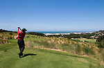 Head golf pro Mark Swift teeing off at hole #15 on the course at Salishan Spa & Golf Resort, central Oregon Coast..#06061620