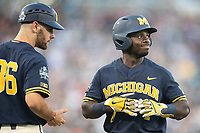 Michigan Wolverines second baseman Ako Thomas (4) at first base against the Vanderbilt Commodores during Game 3 of the NCAA College World Series Finals on June 26, 2019 at TD Ameritrade Park in Omaha, Nebraska. Vanderbilt defeated Michigan 8-2 to win the National Championship. (Andrew Woolley/Four Seam Images)