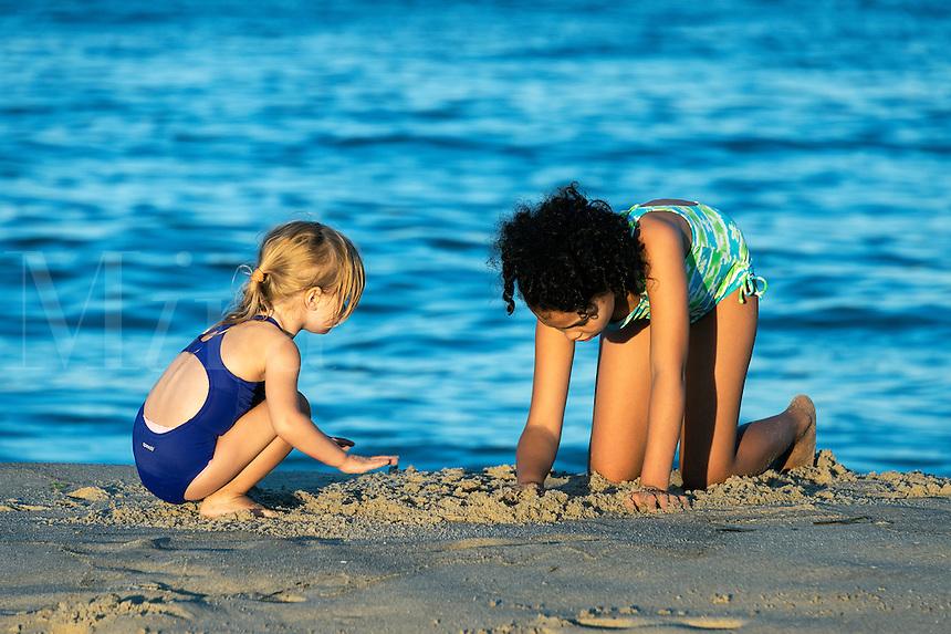 Girls play at the beach, Cape Cod, Massachusetts, USA