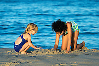 Girls play at the beach, Cape Cod, Massachusetts, USA