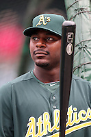 Oakland Athletics first baseman Chris Carter #22 before a game against the Los Angeles Angels at Angel Stadium on September 24, 2011 in Anaheim,California. Los Angeles defeated Oakland 4-2.(Larry Goren/Four Seam Images)