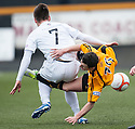 Alloa's Kevin Cawley is caught late by Ayr Utd's Adam Hunter.