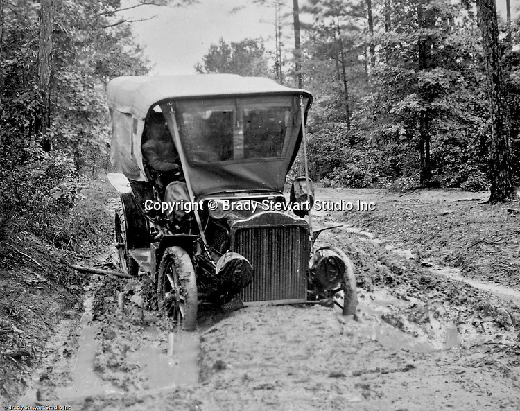 Westmoreland County PA:  Brady Stewart's 1906 Buick is stuck in the mud along a county road near the Pittsburgh to Greensburg Turnpike.  Needed a team of horses to pull him out so he could make repairs.