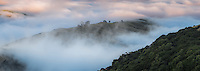 Rolling clouds over farmland on Banks Peninsula, Canterbury, South Island, New Zealand