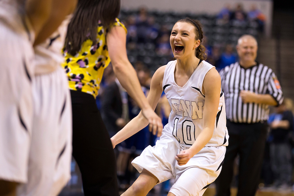 Penn guard Kaitlyn Marenyi (10) reacts in the closing seconds of a 68-48 win against Columbus North in the IHSAA Class 4A Girls Basketball State Championship Game on Saturday, Feb. 27, 2016, at Bankers Life Fieldhouse in Indianapolis.