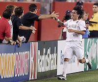 The MetroStars' Sergio Galvan Rey celebrates with the bench after his goal in the 68th minute put the MetroStars ahead 2-1. The New England Revolution defeated the MetroStars 4 to 2 at Gillette Stadium, Foxbourgh, MA, on June 25, 2005.